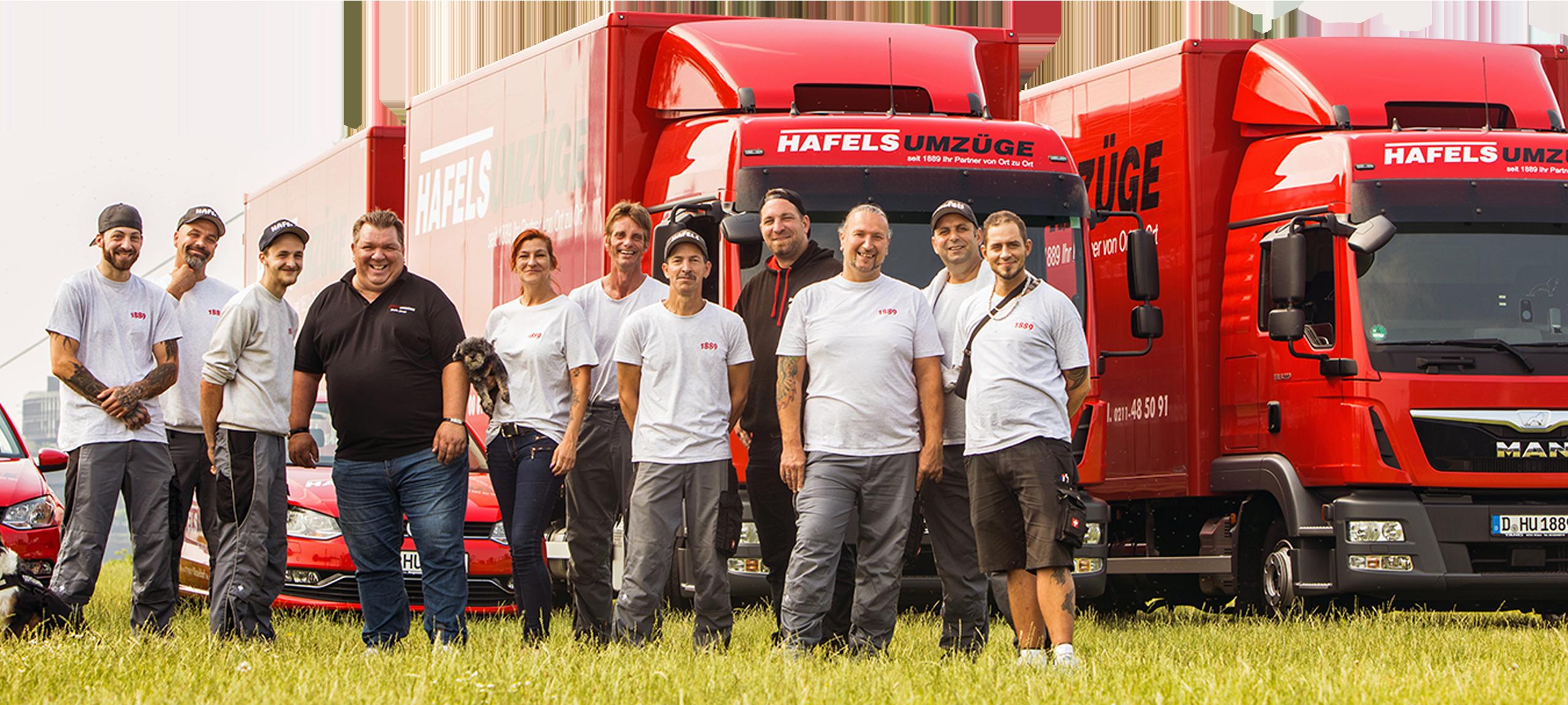 Team von Hafels Umzüge vor 2 roten LKWs
